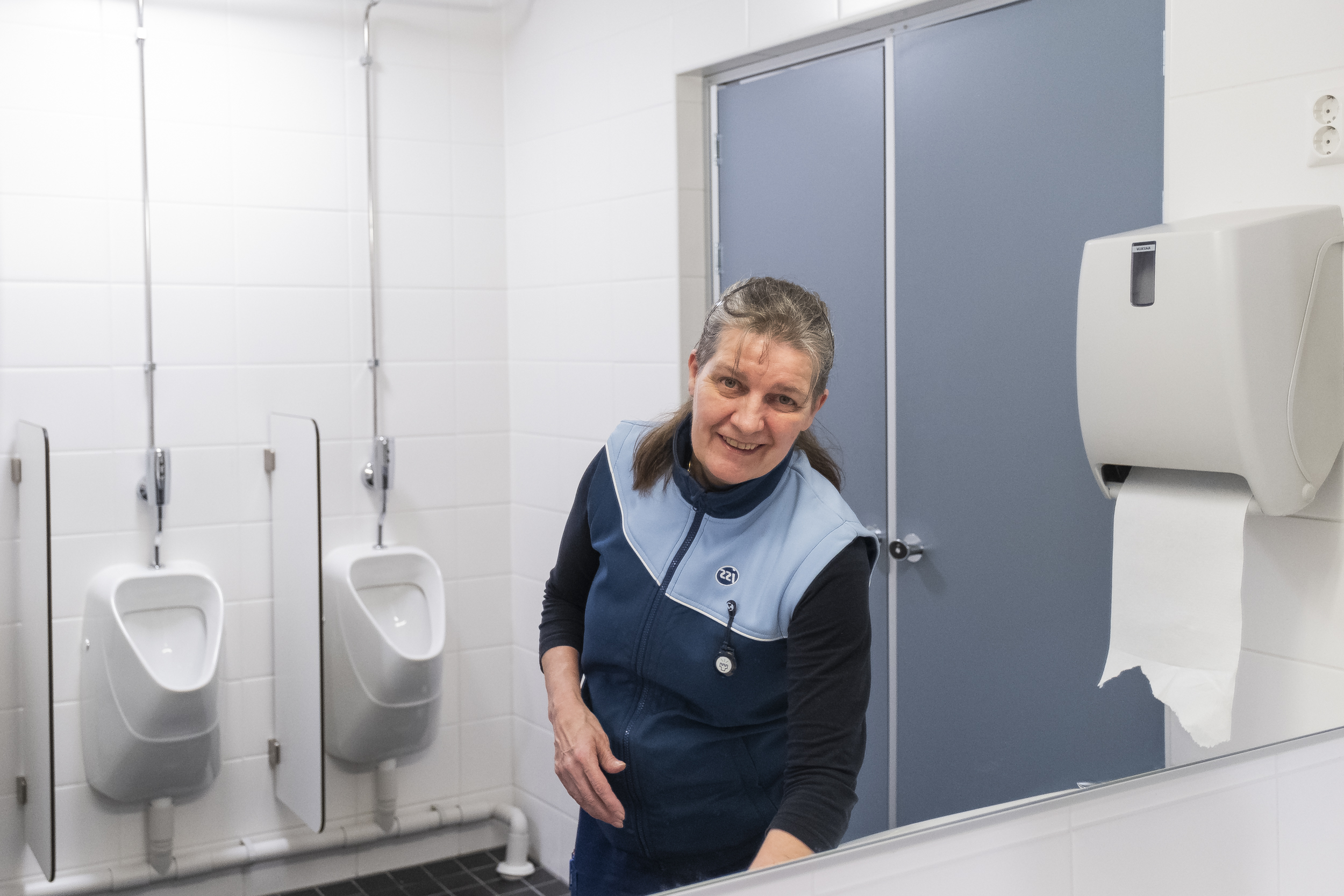 Shot for Oulun Ylioppilaslehti in January 2020. Pictured is a a clening lady in the campus bathroom of University of Oulu.